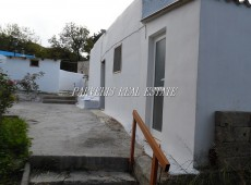 Stone house and plot for sale in Pyli, Kos.